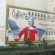 1 ,Mozart, Wohnungsbaugesellschaft, Fassadengestaltung, Giebelmalerei, Fassadenmalerei, Malerische Gestaltung, Gemälde, Illusionsmalerei , Trompe l'oeil, künstlerische Objektgestaltung, Graffiti